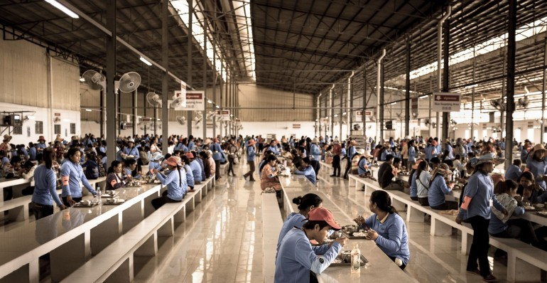 Cambodian garment workers lunch in the factory