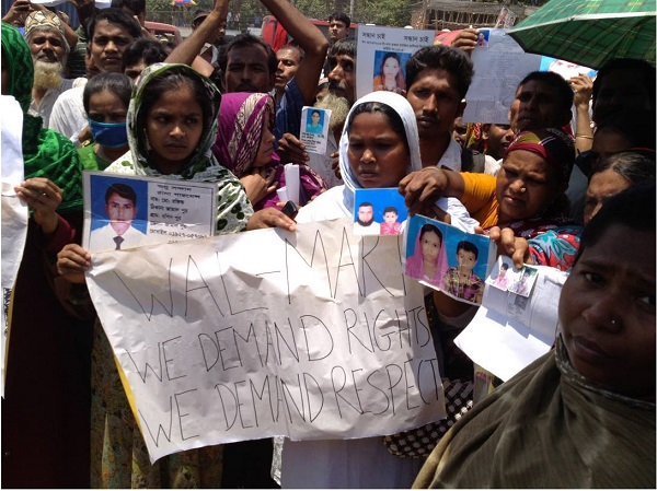 Activists stage a protest against Walmart on the first anniversary of the Bangladesh Rana Plaza disaster. Credit: Reuters