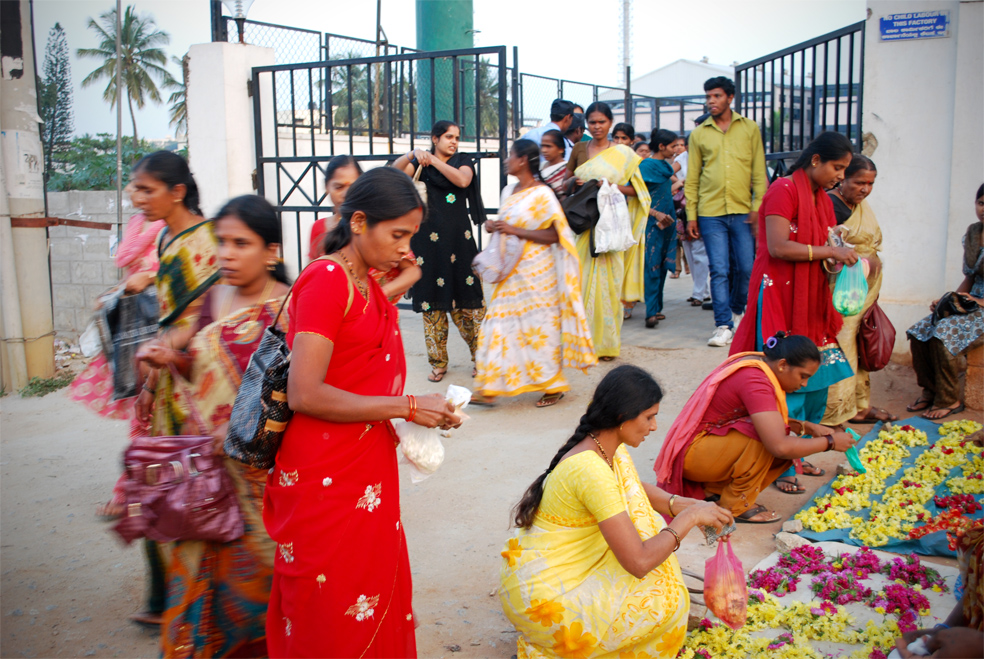 Indian workers spill out of factory